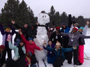 over-sized snowman and skiers that built him