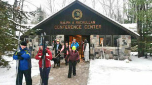 Skiers carrying cross country ski's leaving Ralph McMullen Conference Center