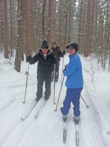 Three skiers on the trails at MSFL