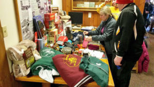Woman arranging items for MSFL fundraiser auction