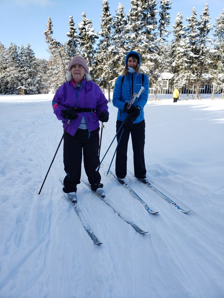 Cheryl Wade and her guide, both on ski's