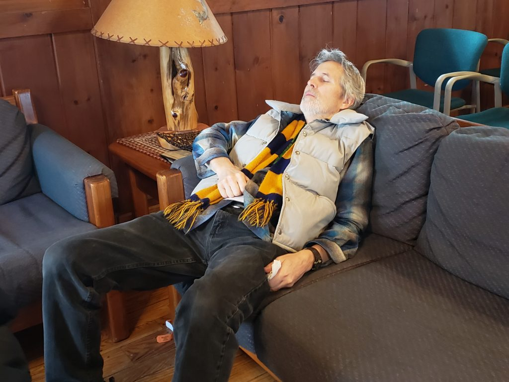 Hal Wolfe catches some z's on a couch in the conference center
