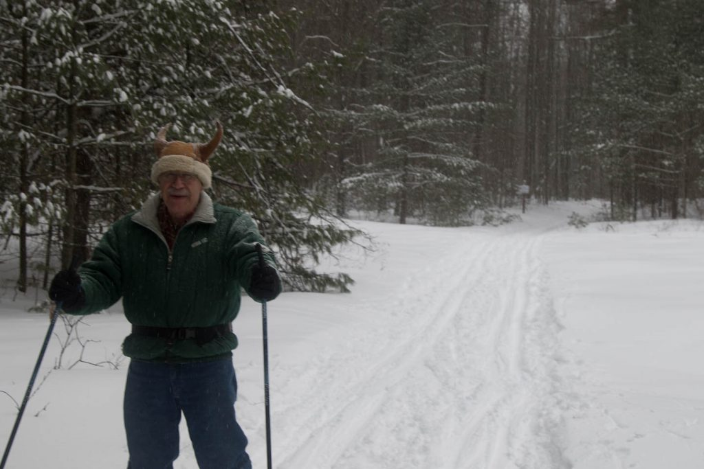 Jim Ellickson with his deer-antler hat ski's on the intermediate trial