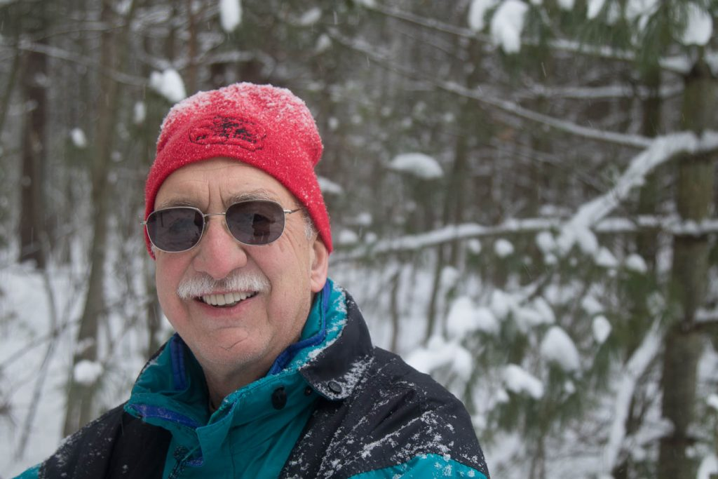 Smiling face of a volunteer on the trail