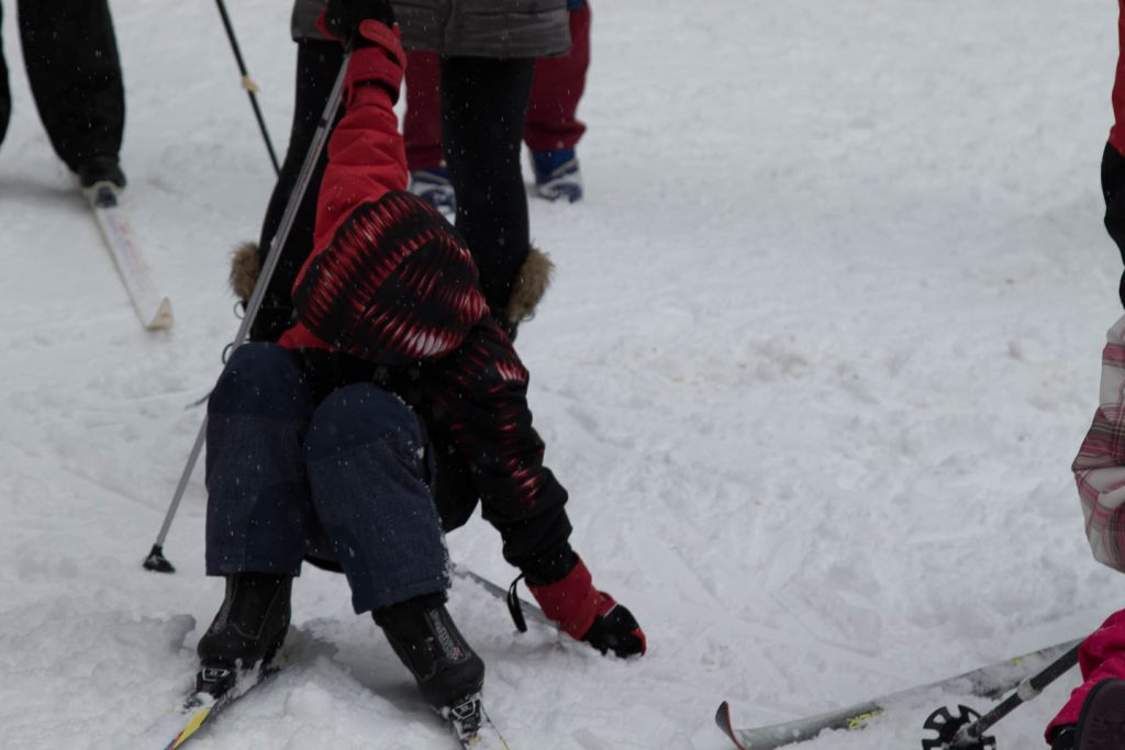 Trying to get up after falling down on ski's