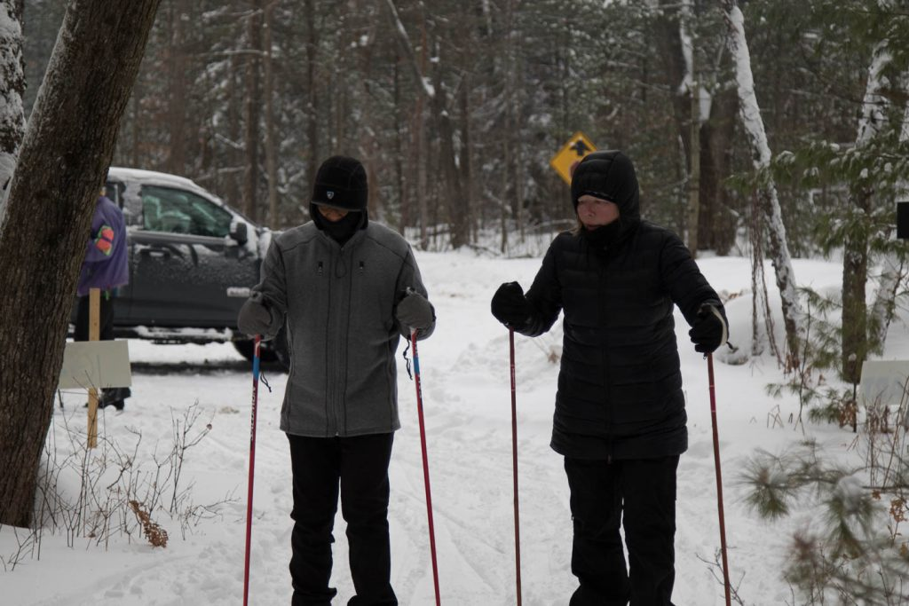 Guide instructing skier